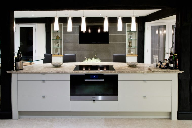 A contemporary styled, monochrome kitchen with flat cabinet doors