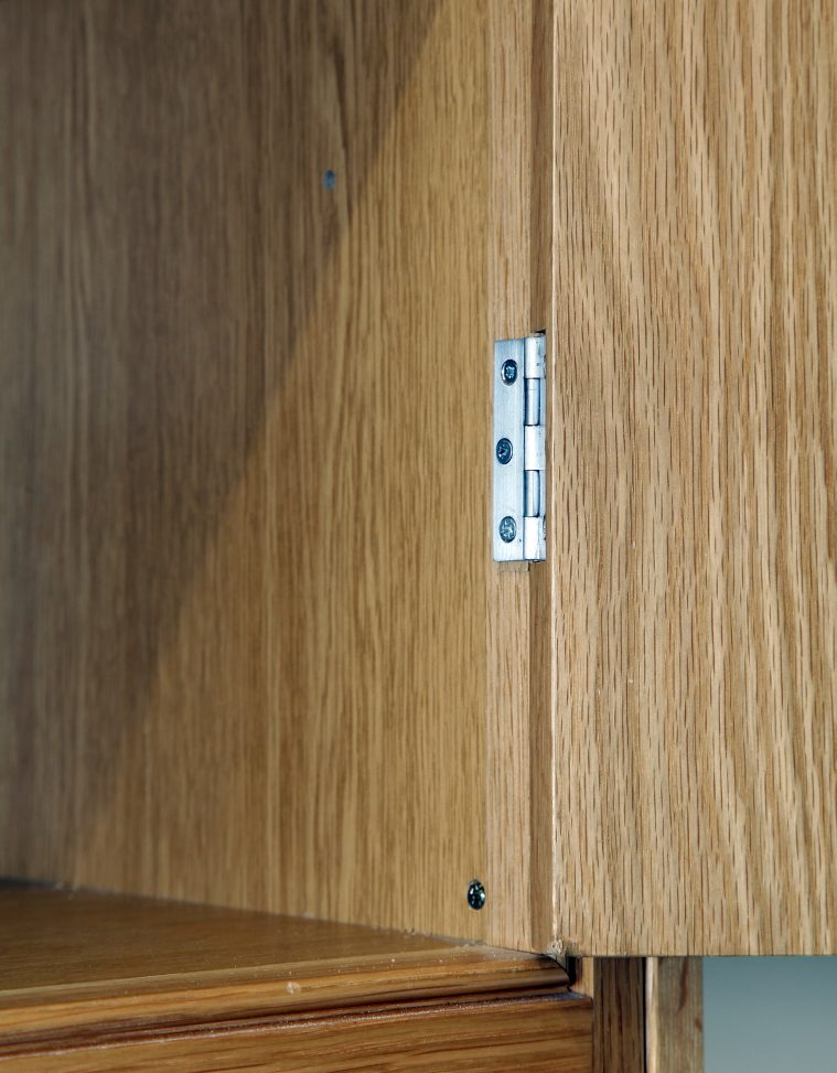 Close Up Of An In-frame Cabinet Showing The Butt Hinge