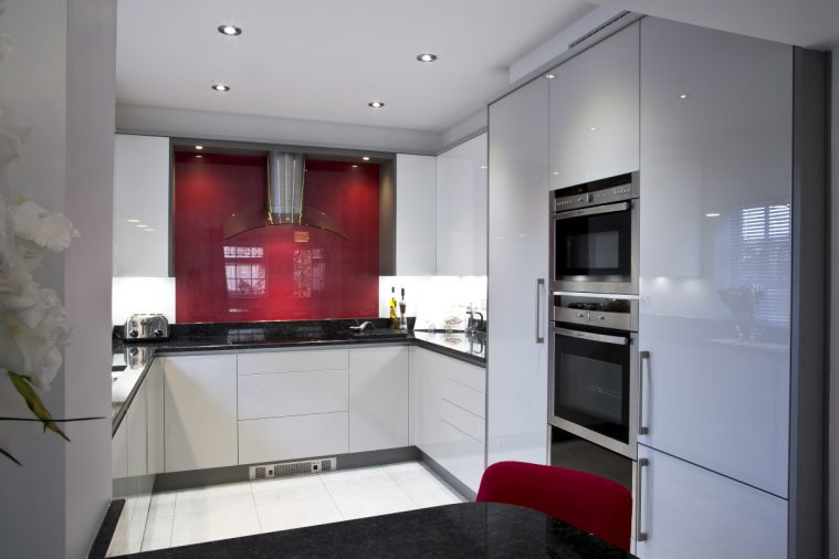 Our new kitchen for the Cain family in Hayes in gloss white/grey with a splash of red