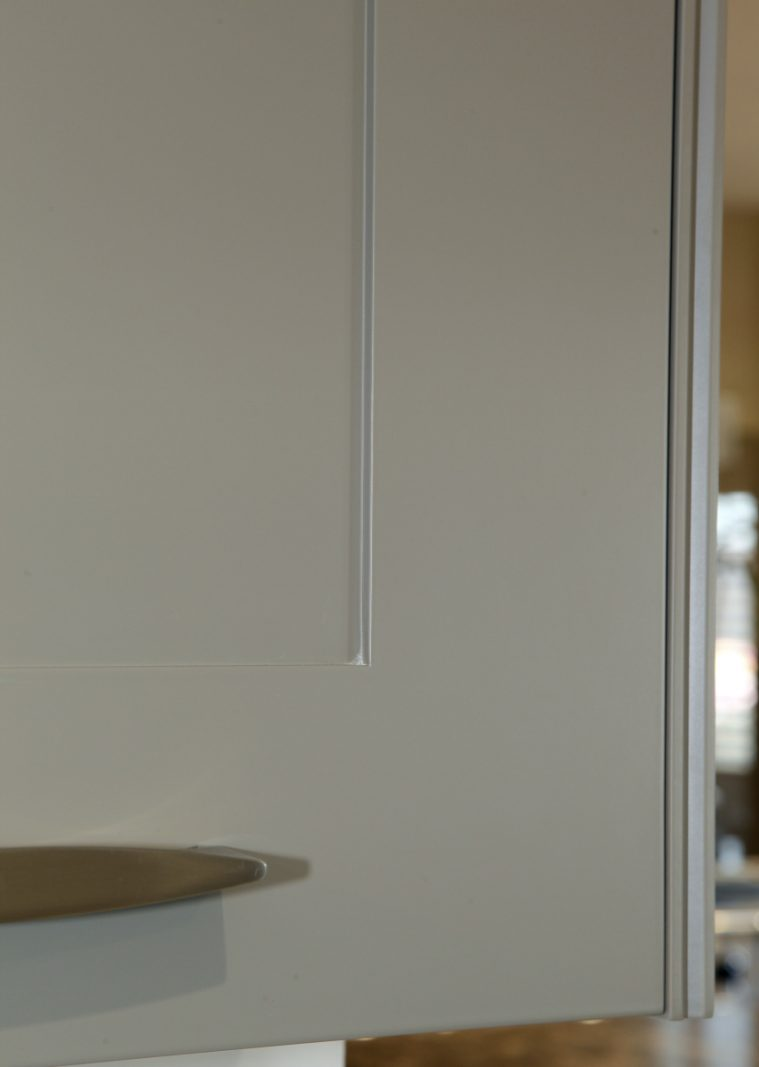A Close Up Of A Lay-on Kitchen Cabinet With Hidden Blum Hinges