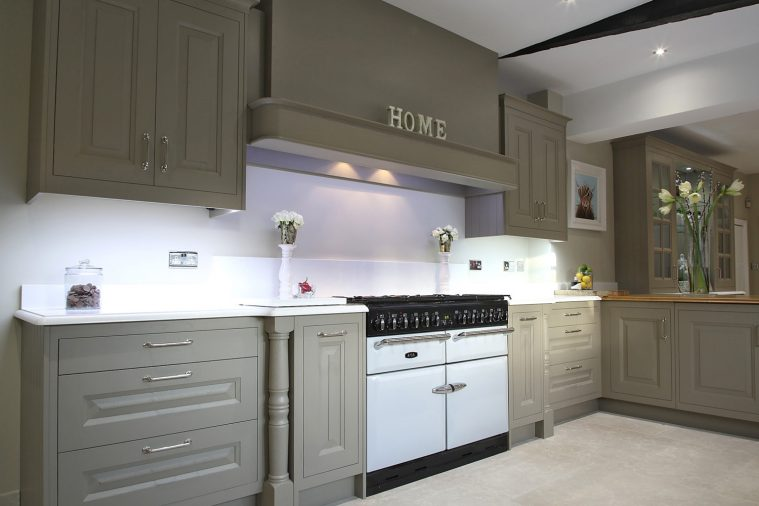 A contemporary raised and fielded style kitchen in warm grey