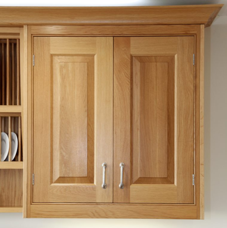 Raised and fielded kitchen cabinet doors in natural wood