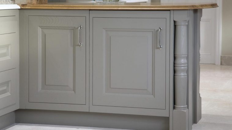 Detailing of raised and fielded kitchen cabinet doors in grey