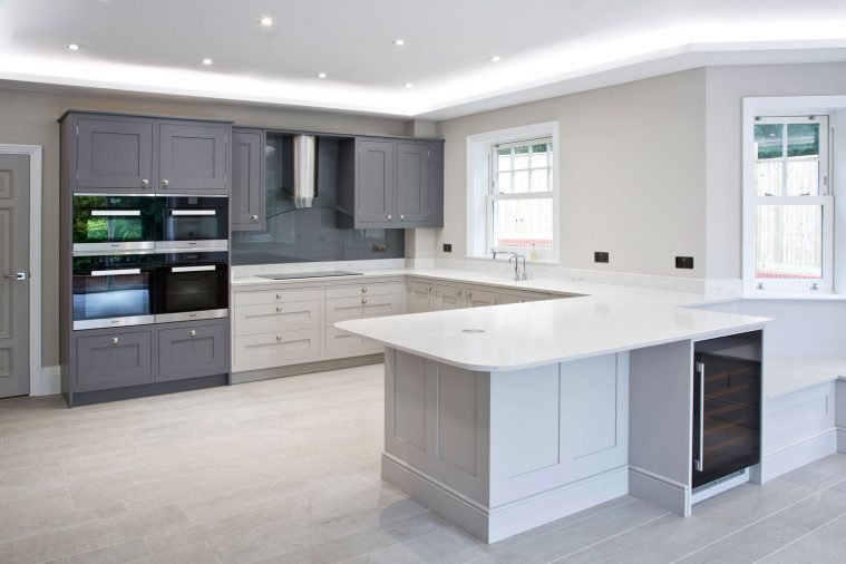A contemporary shaker style kitchen in white and grey